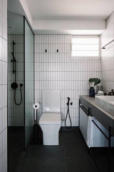 Straight lines and edges define this monochrome bathroom
