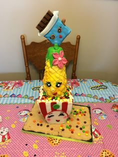 Shopkins Cake - Poppy Corn, Pineapple Crush & Cheeky Chocolate.   Vanilla Tye Dye cake on the inside.