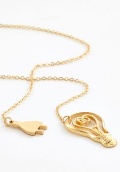 I'll Have Watt She's Having Necklace. Illuminate your quirky style with this light bulb necklace and youre sure to spark a trend! #modcloth