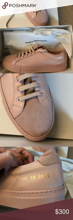 Woman by Common Projects Achilles Premium Low Blush color, brand new, never worn. They are a 39, but these run large. I'm an 8.5-9, but they are about one size too large. I would recommend for those with a size 9 1/2 -10 women's shoe. They have a suede front. Includes extra laces, box and dust bag/protector. Woman by Common Projects Shoes Athletic Shoes