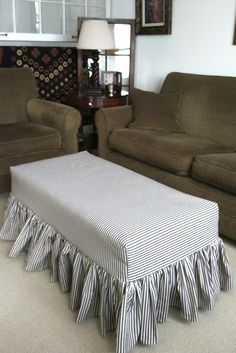 I love the ottoman slipcover I designed and sewed out of pillow ticking fabric.