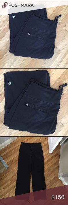 """Vintage Lulu drawstring pants, back zip pocket EUC Vintage Lululemon Luon Black pants with à back zippered pocket, drawstring waist, drawstring leg openings.  Waist 15"""" flat with enough drawstring to tighten or loosen as needed.  Material is also stretchy.  There is no size anywhere.   I suspect these are a size 10.  Inseam is 30"""".  Leg opening 9"""" flat.  Hips 18"""" flat. I love these pants! I wish they still fit me.  They have very little piling and are in great condition.  Vintage Lulu Lasts…"""