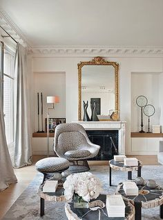 Modern Parisan chic with contemporary patterns and old style fireplace and mirror