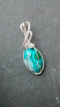Check out this item in my Etsy shop https://www.etsy.com/listing/273819058/gem-silica-sterling-wire-wrapped-pendant