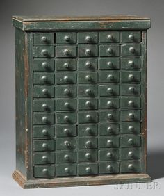 Green-painted Wood Case of Drawers, America, mid-19th century, possibly a jeweler's box, molded top and base, with fifty-five small dovetail-constructed drawers