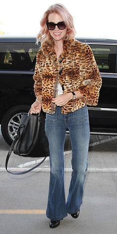 5 Ways to Wear Flares | WITH A CROPPED COAT  | January Jones knows the secret to wearing flares – they need to fit slim through the thigh and knee. And she shows off the perfect fit of her J Brand denim, topping it with a jacket that cuts at her waist. (Plus, Amal Clooney is also a fan of the leopard-coat-and-flares combo, so you know its cool.)