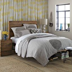 Curtain wall behind bed