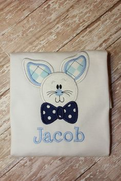 Our adorable boys bow tie Easter Bunny shirt is the cutest shirt for an Easter egg hunt. This Shirt has a Easter bunny wearing a bowtie. Name is embroidered under design. This shirt is an appliqué and