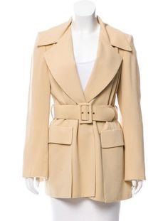 #CELINE | Pale yellow Céline wool coat with structured shoulders, notched lapels, buckle accent at waist, dual slits featuring dual flap pockets at sides and button closure at waist. Michael Kors Era.