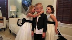 What a handsome ring bearer and precious flower girls!