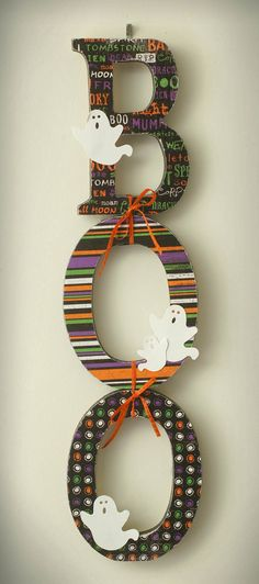 "Cute ""BOO"" sign made with wood letters, scrapbook paper, and embellishments.  Love the way they are tied together!"