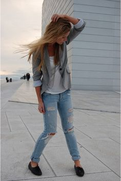 casual yet classy. ripped, distressed jeans, white blouse, gray blazer.