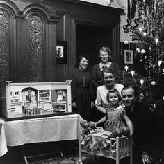 german christmas, love the four dolls on the bead and the doll house on the table