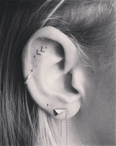 delicate ear tattoo