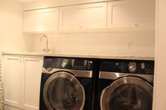 Sleek, functional laundry room with upper cabinets installed on the side to save room and space as well as making room for the soffit.