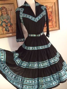 Stunning 1950s Black Squaw Patio Dress with Matching Belt--Turquoise and Silver Ric Rac by AwwwShucks on Etsy https://www.etsy.com/listing/199531070/stunning-1950s-black-squaw-patio-dress