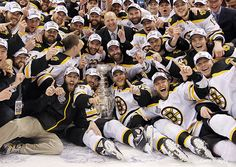 Boston Bruins - Stanley Cup 2011 winners.  I love the team photos with the Cup - always so many huge smiles.