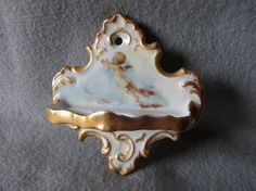 SOLD.....Antique French Limoges Toothbrush Holder with Cherub Angel