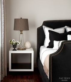 Black & white bedroom, notice how the meander pattern adds complexity to the room