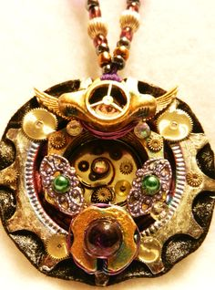 Steampunk Bike Gear Medallion Pendant, Decorative painted punk pink & purple accents, tarnished patina paint varnish, tiny watch & clock parts detailing & filigree , sterling silver & gold tone metallic beads & purple glass beads.