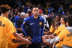 Stephen Curry of the Golden State Warriors high fives fans before the game against the Denver Nuggets on November 4 2017 at the Pepsi Center in...