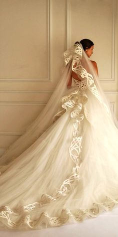 Spring Wedding Dresses With Gorgeous Architectural Details ❤ These spring wedding dresses have strict, geometric shape and laconic minimalism in details. See more: http://www.weddingforward.com/spring-wedding-dresses/ #wedding #dresses
