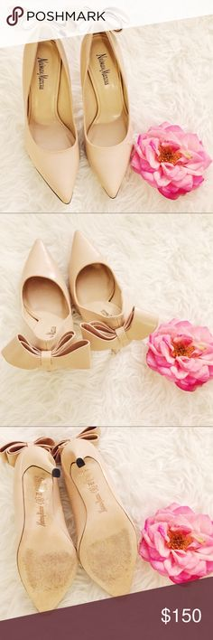 Neiman Marcus Nude Bow Leather Pumps Neiman Marcus Nude Bow Leather Pumps. 4in stiletto heel. Great condition. Pointed Toe. Size 9. Neiman Marcus Shoes Heels