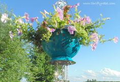 How to repurpose a metal strainer into a planter and a wind chime