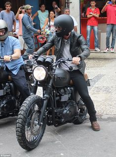 Looking cool: The football ace looked every inch the biker dude as he filmed footage on hi...