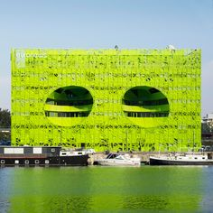 Jakob + MacFarlane's new Lyon headquarters for news channel Euronews features an acid-green facade punctured by two huge egg-shaped holes