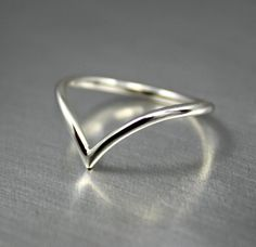 Dainty sterling silver chevron ring. The design is two subtle curves and pointed detail. Handmade in 1.6mm wire. Available in shiny finish,