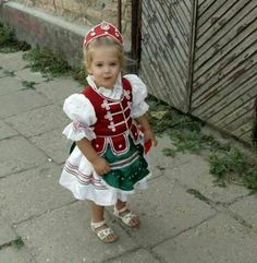 Beautiful hungarian little girl traditional folk costumes