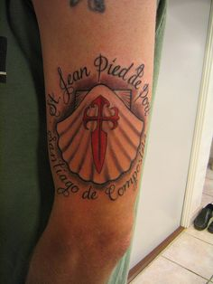 I would like to get a much smaller tattoo - the Camino shell with the cross....