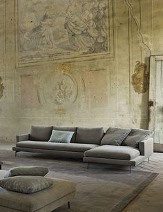 grey sofa and crumbling old walls