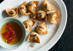 Kylie Kwong's crispy cricket & prawn wontons with chilli sauce.