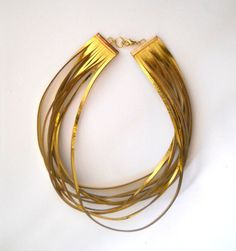 Gold leather necklace by Smadars on Etsy, $48.00