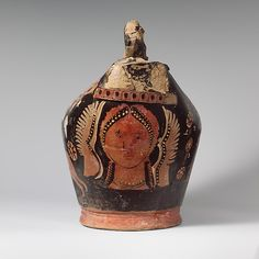 NIKE| Compared to the Mignot Painter | Terracotta askos (flask with a handle over the top) | Greek, South Italian, Apulian | Hellenistic | The Met