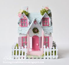 Well, I had immense fun with this little project! I recently bought some of Tim Holtz's Sizzix Village dies, and got to have a play with th...
