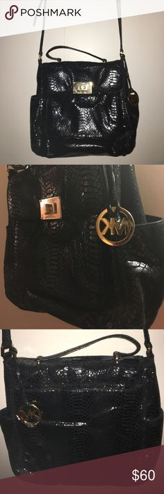 MK PURSE ✨ Michael Kids • shoulder bag AND top handles •7 pockets total ! •  2 on the side• 1 in the front • the main pocket • a zipper pocket • 2 slot pockets inside of that • and one along the back ( VERY CONVENIENT) • I LOVE this purse • shiny black snake print • gold hardware • large MK logo attached • 4 gold studs on the bottom of the bag • excellent used condition ✨ Michael Kors Bags