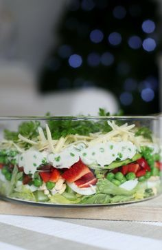 easy layered salad recipe, perfect for special occasions or Christmas...layer up and prepare the day before, keeps well for 24 hours!  more easy ideas abeachcottage.com