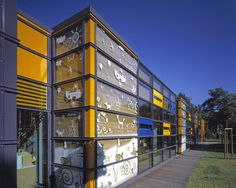 An interesting example of kindergarten in Warsaw, Poland. The idea for the glass facade was based on rebuses created by children. The drawings were screen printed on glass.