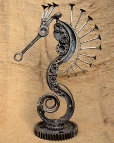Sculpture from scrap by Volodymyr Vasyliuk (Ukraine). (Car art sculpture car parts Welding Art Projects, Recycled Art Projects, Metal Art Projects, Metal Crafts, Metal Yard Art, Scrap Metal Art, Mechanical Art, Metal Art Sculpture, Steel Art