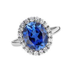 18 Kt White gold natural blue sapphire & round diamond ring