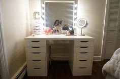bedroom vanity (clear off top except the magnifying mirror - skincare tray will be in the bathroom; use an unframed mirror/add a U shelf at the bottom of the mirror for perfumes)