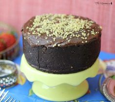This raw chocolate cake recipe is a perfect base for a simple, moist chocolate cake. Walnuts, pecans, dates, raisins, cocoa and vanilla combine in a food processor for a dense, raw chocolate cake. Don't forget the icing!