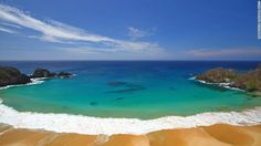 """The number of visitors is restricted on Fernando de Noronha, a UNESCO World Heritage Site. """"The lucky few are rewarded with unrivaled beaches and waters filled with dolphins and sea turtles,"""" says TripAdvisor."""