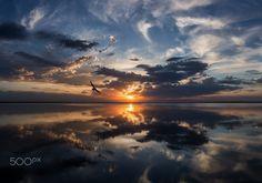 Reflection - Sunset on the lake. Pereslavl-Zalessky. Russian.