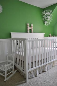 Great wall color, love the mobile and the fantastic crib skirt.  Make sure anything over the crib is secured to the wall.
