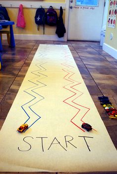 Zig Zag Race Track- great for fine motor skills. I've done this with masking tape on the carpet as well