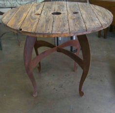 Not a Pallet but a Spool Top Table on a rusted metal base by R John DIAZ